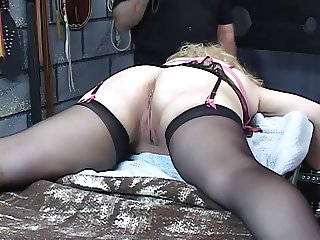 Busty mature blonde gets her ass whipped in the dungeon