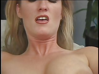 Pretty blonde babe spreads her pussy lips