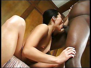 Cute asian deep throats a big black cock