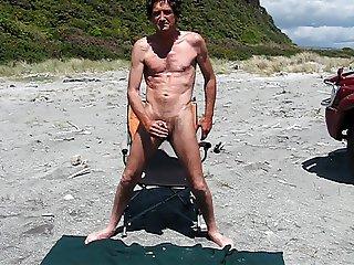 steve wanking on beach 01