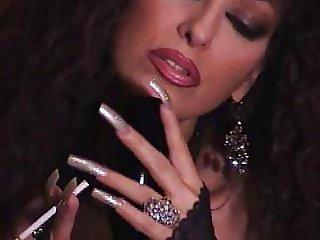 Mature Brunette teasing in pantyhose long nails smoking