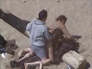 couple having sex on the beach