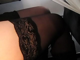 Touching her legs in stockings on a plane 3
