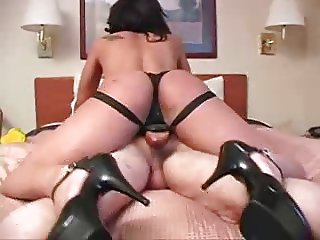 she tearing is ass with a big strapon at the hotel