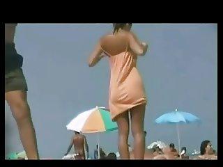 Cute Brunette Showing Ass On Beach by TROC
