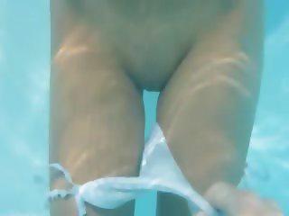 Naughty girl tease in the pool