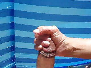 handjob andbig cumshot at the beach