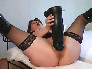Super dildo in mature ruined pussy