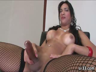 Nasty tgirl Jo Garcia strokes her cock