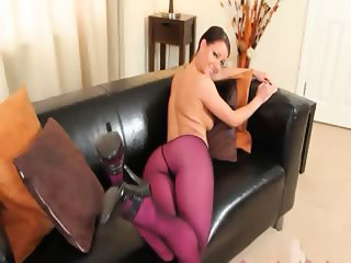 Purple nylon pantyhose on glamorous babe