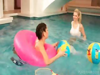 Wet lesbians playing in the pool